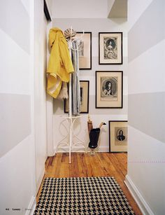I would love to come home an entry hall like this. The stripes, rug, coat rack, vintage photos. I'd even take that yellow jacket. Via Marcus Design (marcusdesigninc.blogspot.com) Photo from the March/April issue of Lonny (http://lonnymag.com/issues/16-march-april-2011-issue/pages/1).