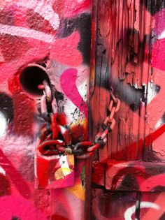 Picture of Graffitti - Vila Madalena -SP-Brasil Wall, old door, padlock every part of this facade with Sliks graffitti! LOVE IT