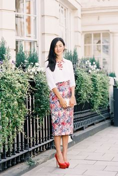 Crisp blouse, statement necklace, floral midi skirt. Done!