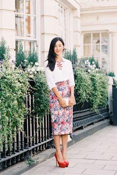 Crisp blouse, statement necklace, floral midi skirt. Done!