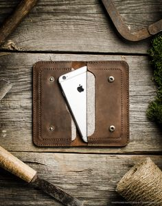 This simple wallet was designed to hold two phones, your cash or cards in one compact and safe haven. Two compartments are wool lined so phone is well protected. DESIGNED FOR: iPhone 6 / 6s iPhone 6 / 6s plus iPhone 7 / 7 plus iPhone SE Separate parts of each product are being cut by hands, a lot of attention is being paid to seams, symmetry and details. All products are unique and thoroughly made.