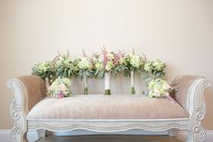 Vintage velvet sofa arrayed with bouquets for the bride and bridesmaids | Rock Island Lake Club, Northern New Jersey Wedding Venue | Tina Elizabeth Photography