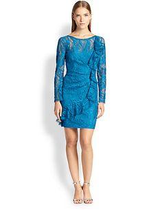 Brand/Designer: Emilio Pucci Material: Nylon /Rayon /Silk Dress Length: Cocktail Shoulder: Long Sleeves Neckline: Bateau Neck Embellishments: Applique Lined Ruffles Sheer Closure/Back: V Back Available Colors: Blue