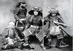 Four samurai wearing armor.