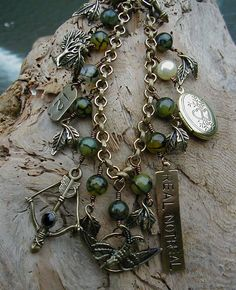 End Of Year Sale - The Hunger Games - REAL - NOT REAL Charm Bracelet with Forest Green Moss Agate Beads and Arrow Clasp.