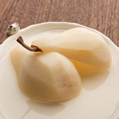 Pears Poached with Vanilla - I love pears in all their forms, but I especially love them poached. Poached pears make a light, delicious, and easy dessert, especially for those on chemo. It allows them to enjoy this wonderful fall fruit when their impaired immunes make snacking on them raw impossible. In Europe they are often cooked with wine, but it's really not necessary for great flavor. A little maple syrup and half a vanilla pod make a heavenly combo that gives pears a rich, deep tast…