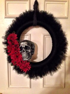 Halloween wreath $19: Clearance pool noodle (.25), 2 rolls of black tulle ($12), styrofoam skull ($4), 2 bunches of fake flowers ($2).