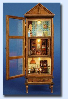 Doll house in a cabinet