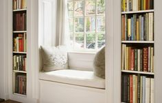 A nice and sunny seat with your books in easy reach and a view to go with it.