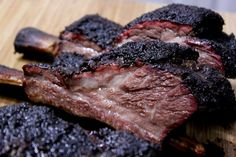 These super meaty smoked beef short ribs are man-sized or sized for anyone who likes beef in a BIG way. There's no wonder some people call these dinosaur ribs! Smoked Corned Beef, Smoked Beef Short Ribs, Smoked Brisket, Rib Recipes, Grilling Recipes, Beef Ribs Recipe, Standing Rib Roast, Smoking Recipes, Grilled Beef