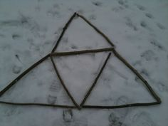 outdoor maths: how many triangles can you make using 9 sticks?