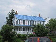 House With Blue Metal Roof Share Houses Siding