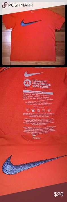 Mens Nike Standard Fit Size XL 100% Cotton Excellent Condition. Nike Standard Fit XL 100% cotton. Orange woth blue and black Nike swoosh across chest. Short sleeves. Nike Shirts Tees - Short Sleeve