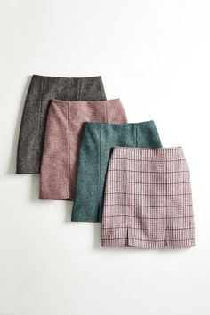 This is tweed – but not as you know it. Timeless British herringbone and check weaves meet a contemporary miniskirt shape with slits at the front. Made from 100% pure wool, sourced from Yorkshire's historic Abraham Moon & Sons mill.