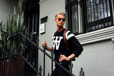 Shirt: Wood Wood Copenhagen Backpack: Royal Republiq Timepiece: Horse Chinos: Dr. Denim Sunglasses: Kaibosh Loafers: Private  All the items is available online at someplace.com.au and at Somewhere Store in Melbourne as well as at Someplace Store in Sydney.  Model: Eric Human Photo: Carl Johan Malmström