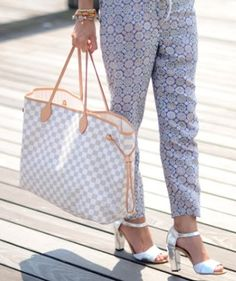Keeping it casual in a light-colored Louis Vuitton tote bag.