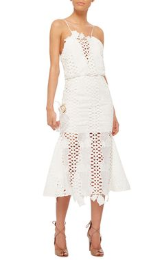 Following a test run selling one-off silk pieces at markets in London, the Australian ex-stylist debuted her eponymous label at Australian Fashion Week in 2004. This sleeveless **Alice McCall** dress is crafted from white broderie anglaise and features lace accent detailing.