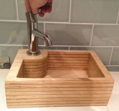 In the process of making a layered plywood hand sink.