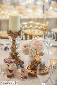 A Disney inspired wedding. This table was Beauty and The Beast with Mrs Potts and Chip. Sweet Avalanche Rose encased in a glass dome. Photo by Michelle Charnock Photography.