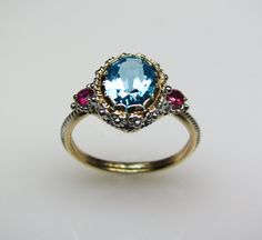 Blue topaz & rubies--ok, now this is gorgeous.