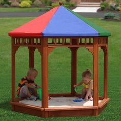 Covered Sand Box. Great idea for Arizona summers.