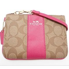 Coach signature wristlet! Super cute coated canvas wristlet! Signature style with hot pink accents. New with tags! Coach Bags Clutches & Wristlets
