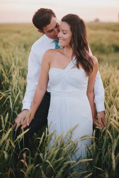Kisses in a wheat field —such a romantic bride and groom shot.