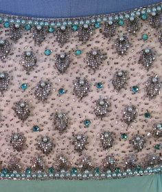 Opulent beading adorns the bodice of a 1960s evening gown by Victoria Royal, Ltd.