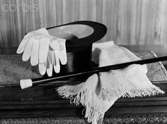1920s 1930s man's formal evening wear top hat white gloves scarf and cane for night on the town