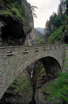 switzerland ravine spanned by arch bridge
