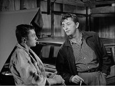 robert mitchum and his son james. they appeared together in thunder road.