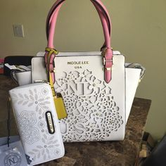 Nicole Lee white purse New .. Designer Nicole Lee .. Come with attachable shoulder strap ... Pink handles & gold details  trades holds ⚠️⚠️firm on price unless bundling... Wallet is separate.. $52 wallet Nicole Lee Bags Shoulder Bags