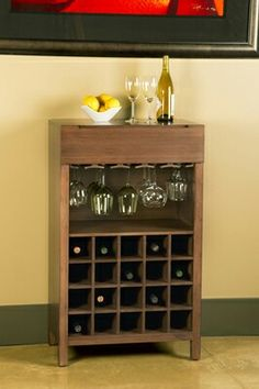 Crafted in solid bamboo, the Orchid Wine Cabinet efficiently stores 20 of your favorite wines! Plus generous room for a selection of wine glasses, as well as a convenient drawer above. x x 41 select from caramelized or dark walnut finish. Moso Bamboo, Wine Cabinets, Wine Rack, Wines, Woodworking Plans, Liquor Cabinet, Drawers, Dark Walnut, Walnut Finish