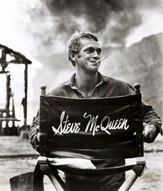Steve McQueen holding his actor's chair
