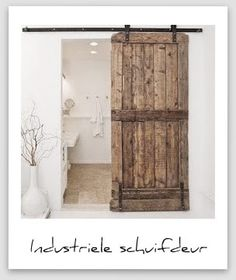 wooden sliding door - could be used to separate two parts of a bathroom