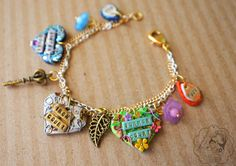The Iron Fey  Charm Bracelet by colourfulblossom on Etsy, $34.75