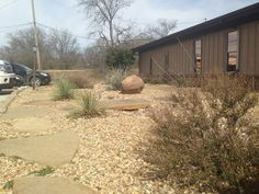 Groundscape, a Fort Worth Landscape Company, designs and installs an xeriscape front yard. Almost no maintenance and very little water.