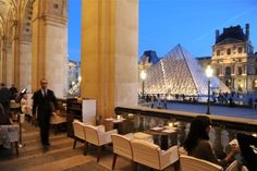 Café Marly in Paris, Île-de-France Contemporary brasserie located in the heart of the Louvre with excellent view on the pyramids. Stylish interior design that reminds of Napoleon and outdoor terrace with heaters and blankets when it gets cold.