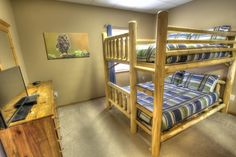 Sasquatch Ridge Pigeon Forge vacation rental cabin - lower level Owl Room has queen over queen log bunk bed and a TV. The mattresses on the bunks are memory foam!