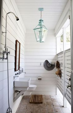 Farmhouse Outdoor Shower With a Turquoise Chandelier.