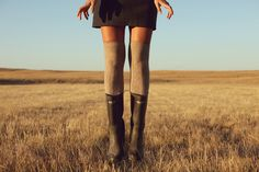 Over the knee socks with black boots.