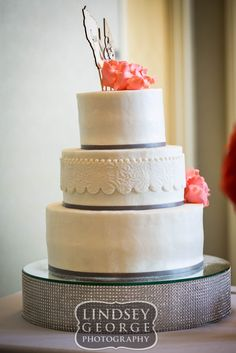 Pretty side view of three tier wedding cake with middle tier texture and cake stand click to view full gallery reception at A View West Omaha Nebraska
