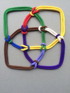 This piece is my first to have eight crossings and so eight colours, the new one added being purple. It is derived from knot 8-19 in the standard mathematical knot tables - the first to be non-alternating between under and over crossings.