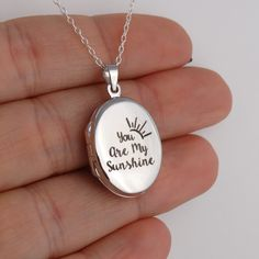 """Engraved You are My Sunshine Oval Locket Necklace - Sterling Silver - Aw. this is the PERFECT locket to hold my favorite baby pic of you! (Remember, """"The One-Shot Wonder? Silver Bracelets, Sterling Silver Necklaces, Silver Earrings, Jewelry Necklaces, Silver Ring, Glass Jewelry, Gold Jewellery, Jewellery Shops, Bridal Jewellery"""