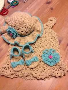 Crochet dress, sunhat, and matching sandals for 12month old. Made for a friend