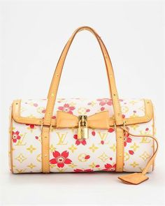 Louis Vuitton Cherry Blossom Papillon Handbag, 7/10 Condition    $1,512 $1,209.60  Description    Brand Name: Louis Vuitton    Item Type: Handbags    Item: Purse    Made In: France    Gender: Women    Condition: 7/10    Material: Coated canvas, cowhide leather trim    Dimensions: approx. 11″ x 5″ x 5″    Dust Bag: Original included
