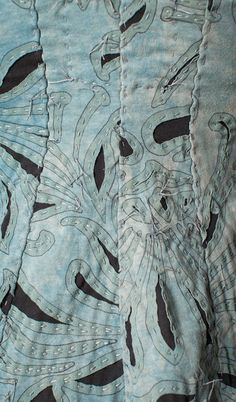 """""""Inked and quilted"""" Magdalena stencil. Fabric is blue-grey on black - nice effect."""