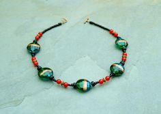 Handmade lampwork glass necklace.   by BijoubeadsLondon £12.50
