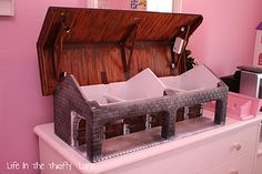 Handmade stable for toy horses - wonder if I could make this out of foam core?