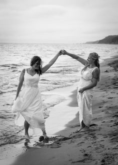 Wives dancing on the beach in black and white by Central Michigan Wedding Photographer Lily Angiolini of Miss Lily Photography in Saugatuck Michigan.   #loveislove #wives #brides #misslilyphotography #beach #wedding #dance